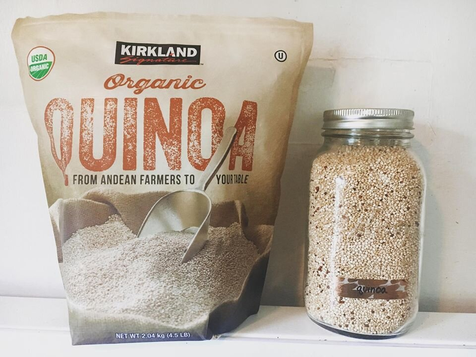 Bag of quinoa from Costco and a mason jar filled with quinoa